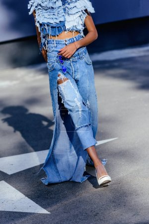 Girl in jeans posing for fashion shoot