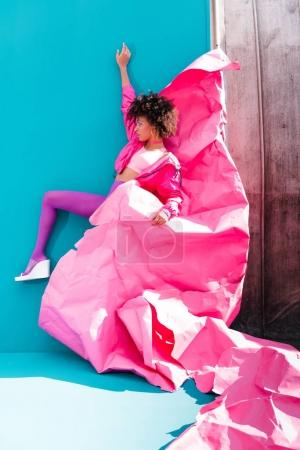 girl posing with pink paper