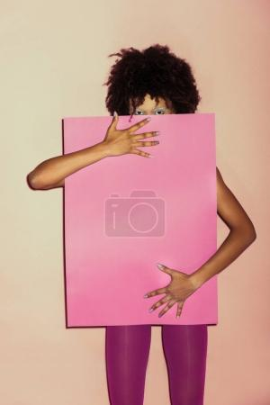 stylish girl with pink paper