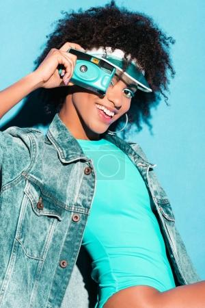african american model with photo camera