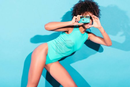 afro model with vintage photo camera