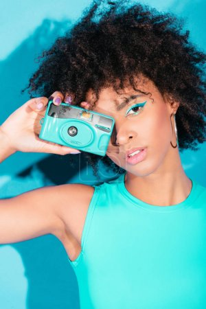 afro model posing with camera