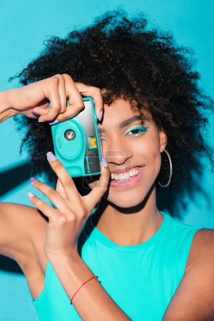afro girl with photo camera