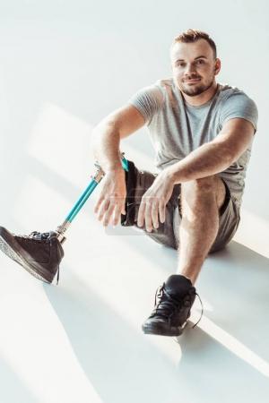 Smiling man with leg prosthesis