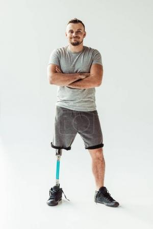 Smiling man with leg prosthesis