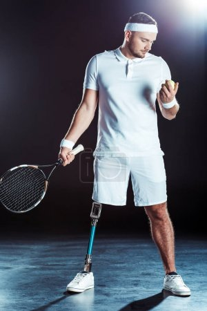 paralympic tennis player with racket and ball