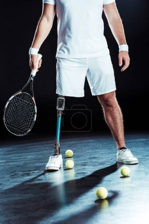 Paralympic tennis player with racket