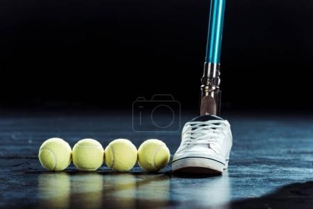 leg prosthesis and tennis balls