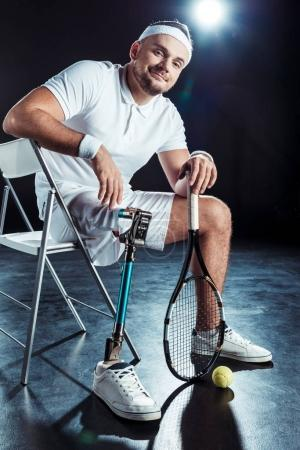 paralympic tennis player resting on chair