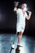 paralympic tennis player with champion goblet
