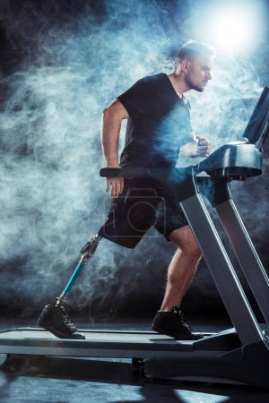 paralympic sportsman exercising on treadmill