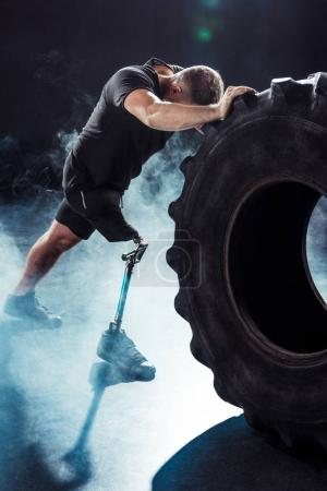 paralympic sportsman pulling tire