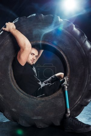 paralympic sportsman sitting in tire