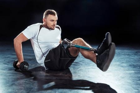 Photo for Side view of paralympic sportsman with dumbbell doing push ups - Royalty Free Image