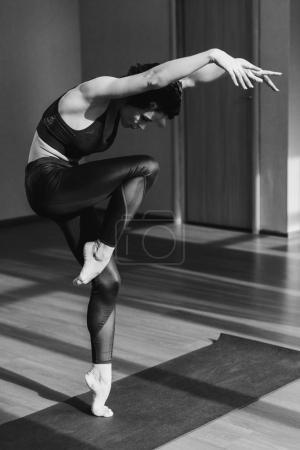 Female dancer training in studio