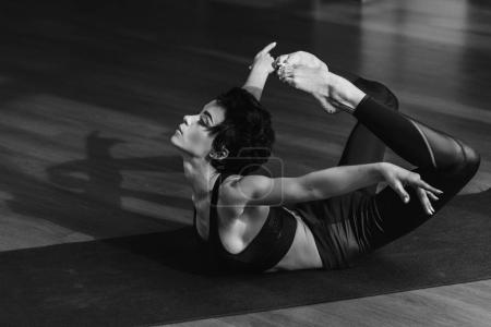 woman in Easy bow pose