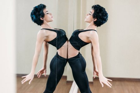 sportive woman leaning on mirror reflection
