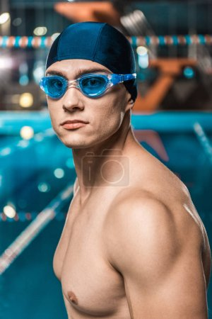 muscular swimmer in goggles
