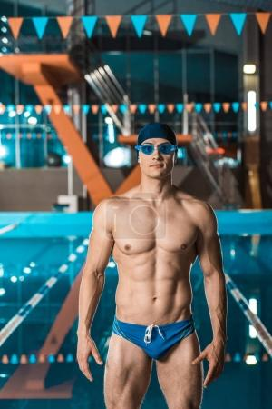 swimmer standing at swimming pool