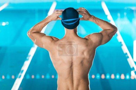 back of muscular swimmer