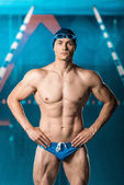 muscular swimmer at swimming pool
