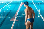 muscular swimmer at pool