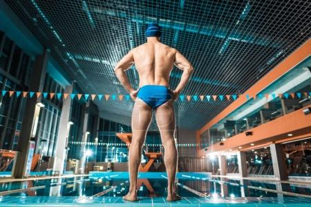 sportsman at swimming pool