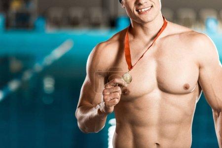 winner holding medal