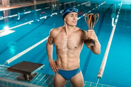 swimmer with trophy cup