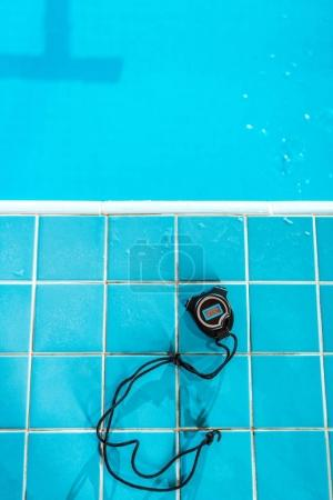 stopwatch at competition swimming pool