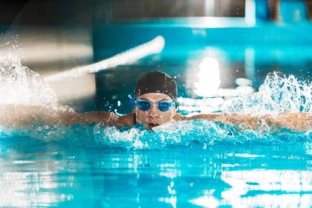 professional swimmer in competition pool