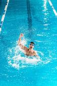 excited swimmer making splash