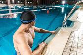 swimmer in swimming cap