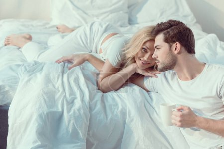 couple spending time in bedroom