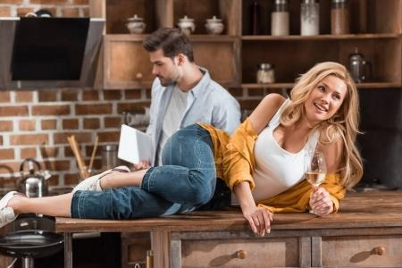 couple spending time on kitchen