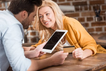 couple making e-shopping with tablet