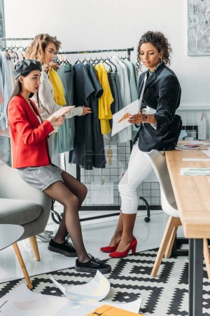 multiethnic fashion designers working together