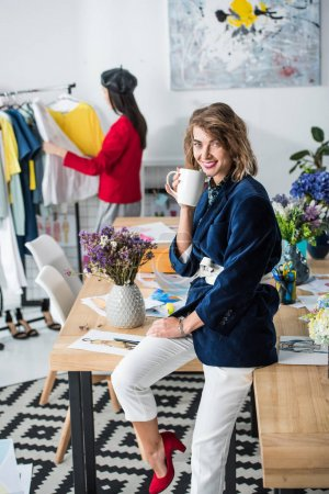 fashion designer drinking tea