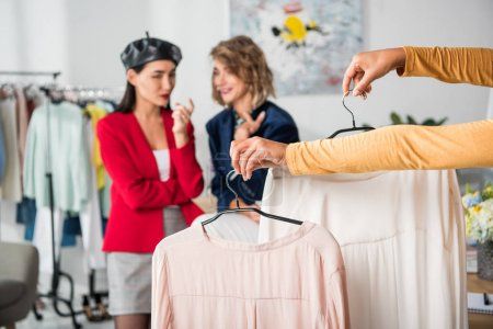 fashion designer holding clothes