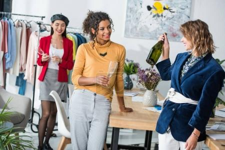 fashion designers drinking champagne