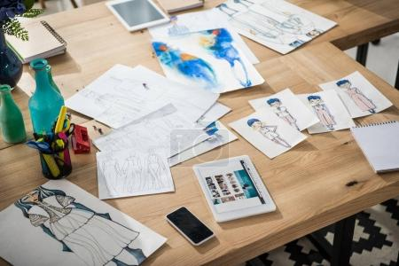 Photo for Digital devices and fashion sketches on table - Royalty Free Image