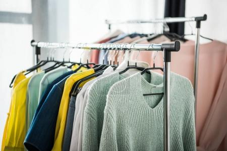 Photo for Close-up view of fashionable female clothes on hangers - Royalty Free Image