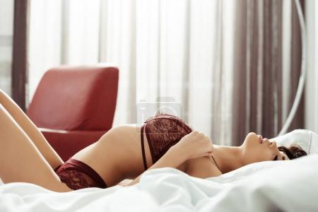 sexy woman in lingerie on bed