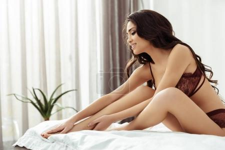 seductive woman on bed