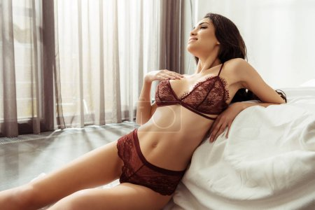 Photo for Beautiful seductive woman in sexy lingerie posing at bed - Royalty Free Image