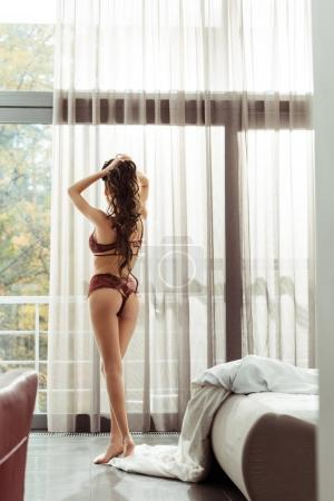 Photo for Back view of beautiful seductive woman with perfect body in sexy lingerie posing at home - Royalty Free Image