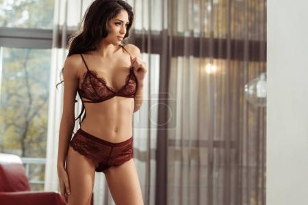 Photo for Beautiful seductive girl in sexy lingerie posing at home - Royalty Free Image