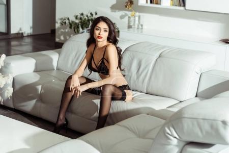 seductive girl posing on sofa