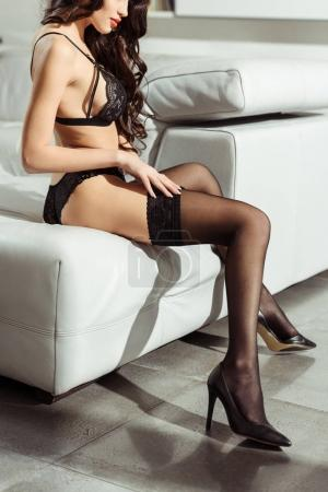 seductive woman in sexy lingerie and stockings