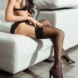 Cropped view of seductive woman posing in black se...
